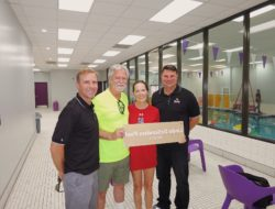 Linda DeSanders, former owner of Dolfin Swim School (now Emler Swim School of Walnut Hill) was presented with a plaque in her honor on August 30, 2018 by corporate and location staff.